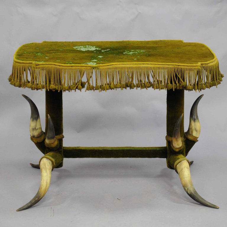 A bull horn table circa 1870, covered with original green velvet which has to be renewed (is loosing the hairs). Manufactured in Austria, circa 1870.  Please contact us for an individual shipping cost calculation.  Measures: length 40.55