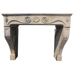 Antique Burgundy Stone Fireplace with Carved Central Shell, 18th Century Italy