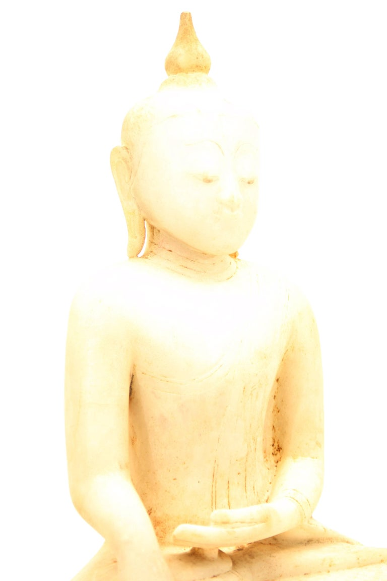 The Buddha is seating in Padmasana (lotus) position, the right hand in bhumisparsha mudra, (calling the earth to witness his victory over the evil king Mara as approaching enlightenment) and the left in dhyana mudra (gesture of meditation), upon a