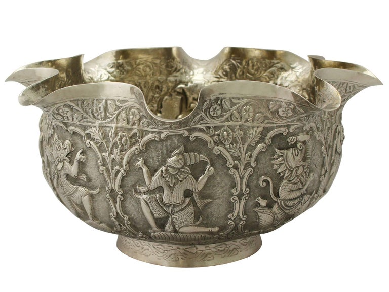 An exceptional fine and impressive antique Burmese silver bowl; an addition to our ornamental silverware collection  This exceptional antique Burmese silver bowl has a circular shaped, rounded form with a flared undulating upper portion.  The