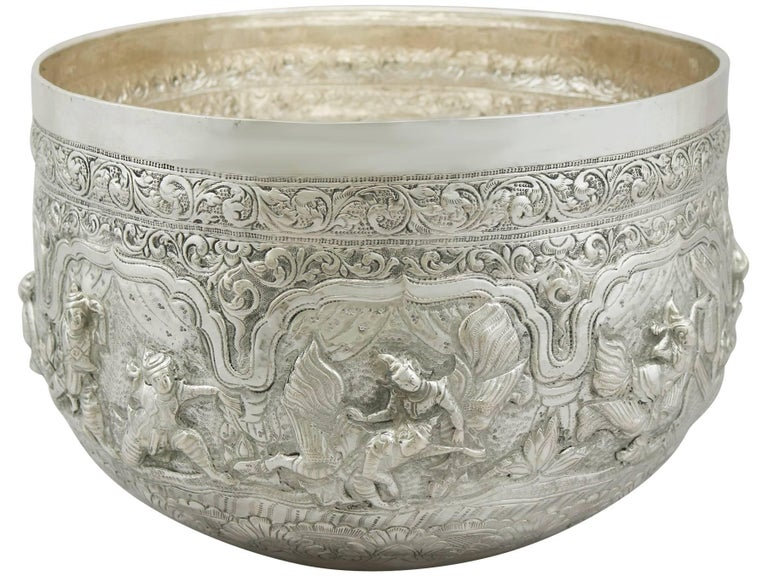 An exceptional, fine and impressive antique Burmese silver thabeik bowl; an addition to our ornamental silverware collection.  This exceptional antique Burmese thabeik silver bowl has a circular rounded form.  The surface of the bowl is