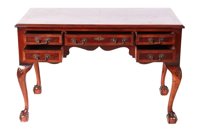 Antique burr walnut freestanding writing desk, having a lovely burr walnut crossbanded top, five crossbanded walnut drawers all with original brass handles, standing on shaped carved cabriole legs with claw and ball feet Lovely color and
