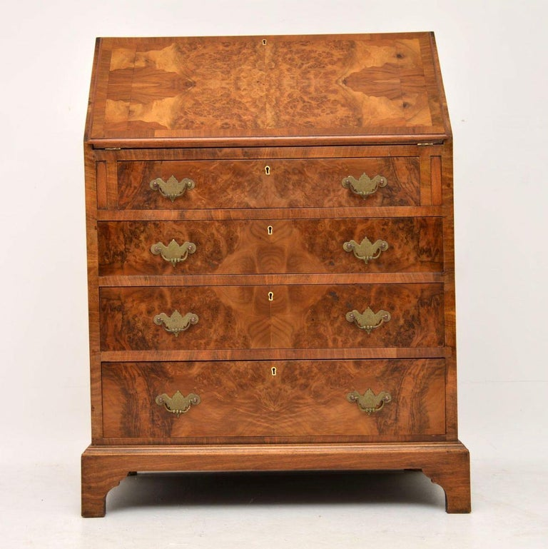 Antique burr walnut bureau dating from circa 1910s-1920s period and in good condition. It's high quality, having fine dovetails on the drawers and a nice interior. The top and slope are cross banded, while the drawers are all graduated in depth with