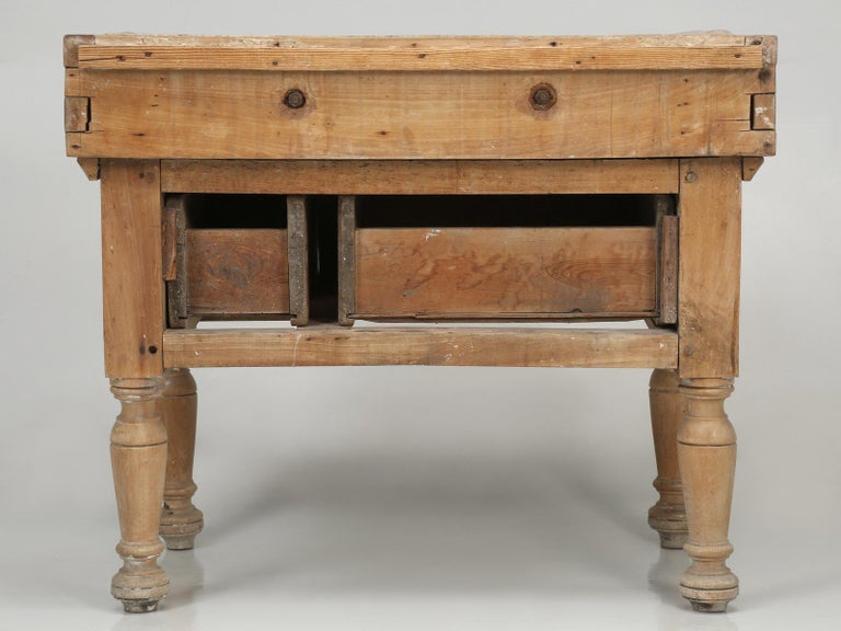 antique butcher block kitchen island constructed of maple