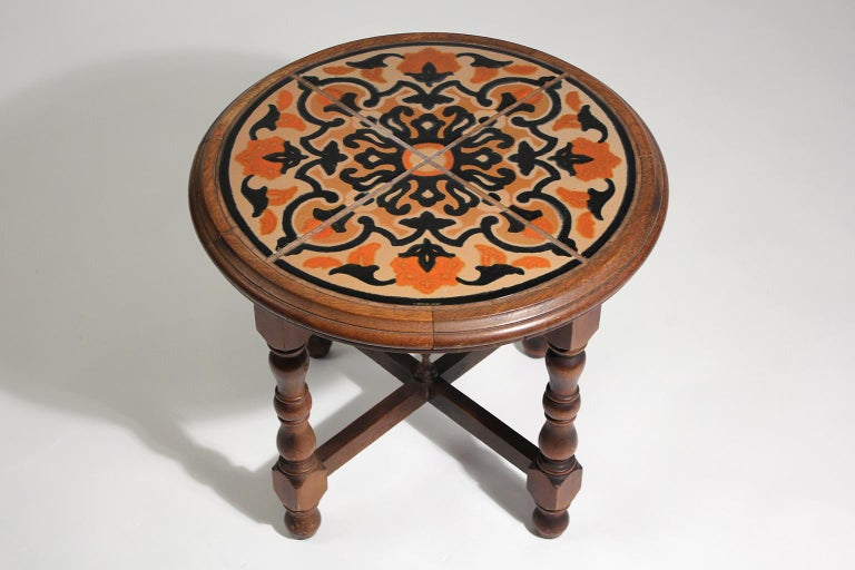Beautiful original antique California Mission Taylor wood and tile top table dating from the 1920s. Has 4 beautiful tiles inlaid into a wooden table. In nice original condition with great color. Rare circle shape and color.