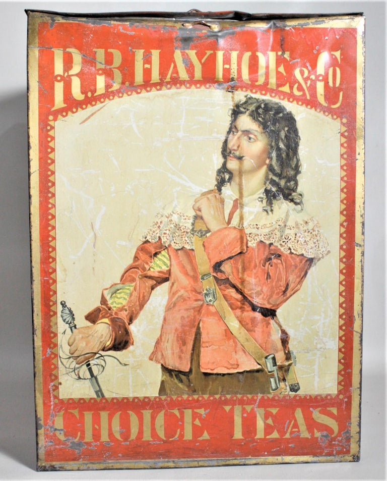 This antique general store advertising store display tin for the R.B. Hay Hoe & Co. tea is presumed to have been made in Canada in approximately 1880 in the period Victorian style. The tin advertises Tea which the Hay Hoe company imported, and the