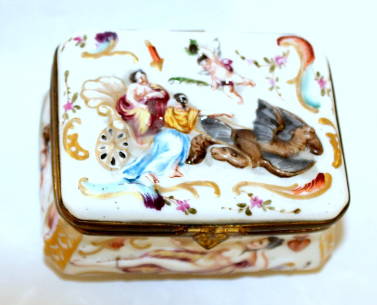 Rare antique Capodimonte type hand decorated hinged box with gorgeous original gilt interior and bas relief decoration on all sides including the bottom (quite unusual). No maker's marks found, but is in the classically decorated Capodimonte