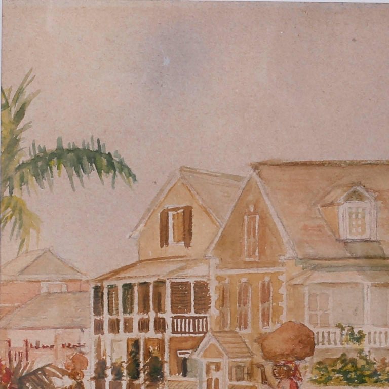 19th century tropical West Indies watercolor on paper depicting a moment in time on a quiet street complete with houses, palm trees, flowers and a woman carrying a bundle on her head. Possibly the Bahamas. Expertly painted and under preservation