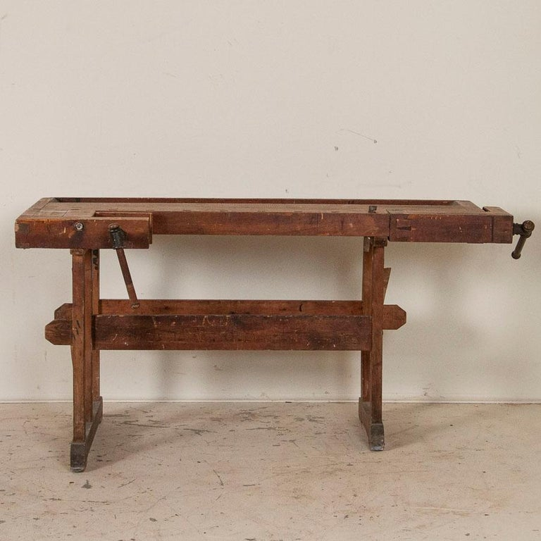Wonderful old antique Danish carpenters' workbench, bearing an incredible patina after years of traditional use. The scratches, dings and even spilled paint only add to the vintage character of the work table. Please examine the close up photos to