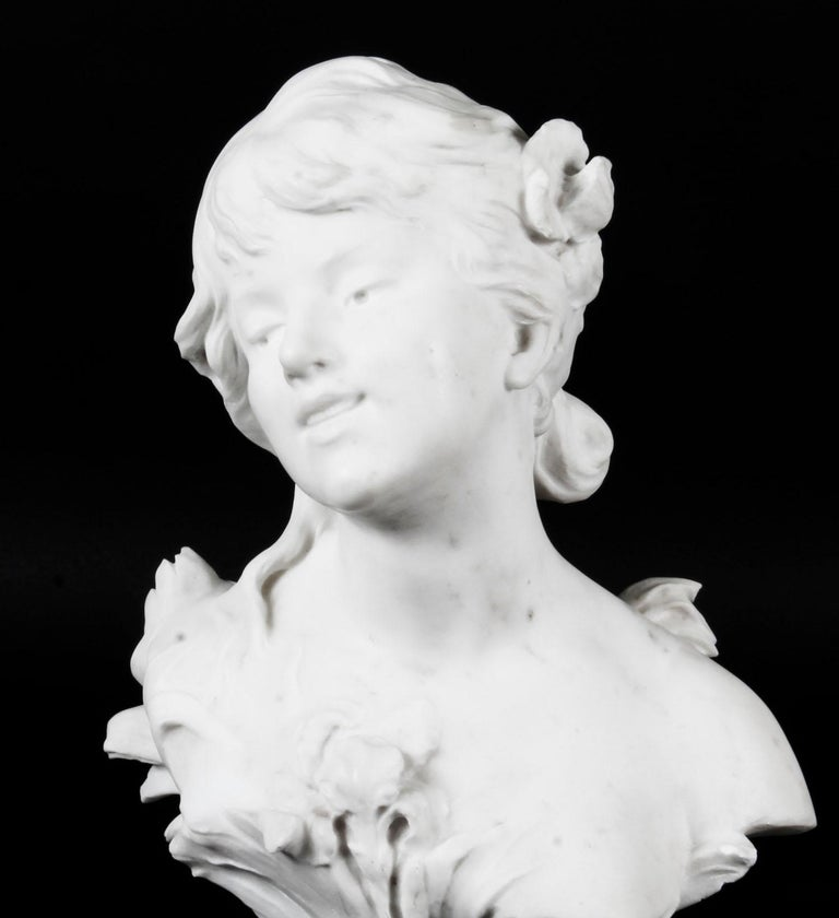 This is beautiful antique French marble shoulder length bust of a beautiful maiden, signed Auguste Moreau, circa 1890 in date. The face and body has been sensitively modelled in Carrara marble with her head tilted to the right, her loose hair
