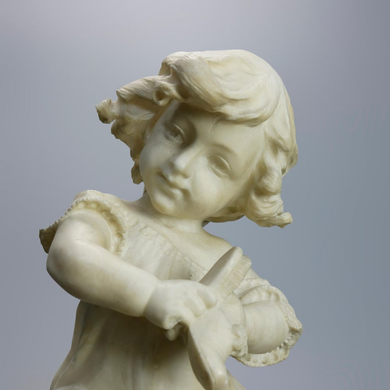 An antique figural sculpture by Adolpho Cipriani (Italian, 1857-1941) offers carved alabaster depiction of a young girl seated on a stool and putting on shoes, artist signed on seat as photographed, c1890  Measures: 18.25