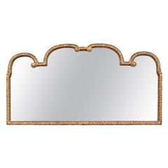 Antique Carved and Gilt Beveled Mirror with Regal Form