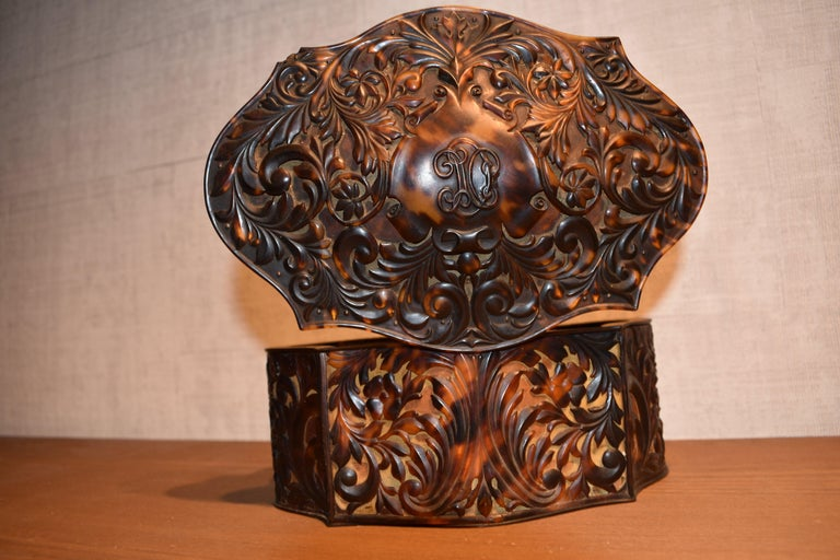 Information: This impressive jewelry box is beautifully crafted. It is covered with carved plates of realistic looking faux tortoiseshell. The carvings are very detailed and sophisticated; in addition the box has a rare shape. The inside is lined