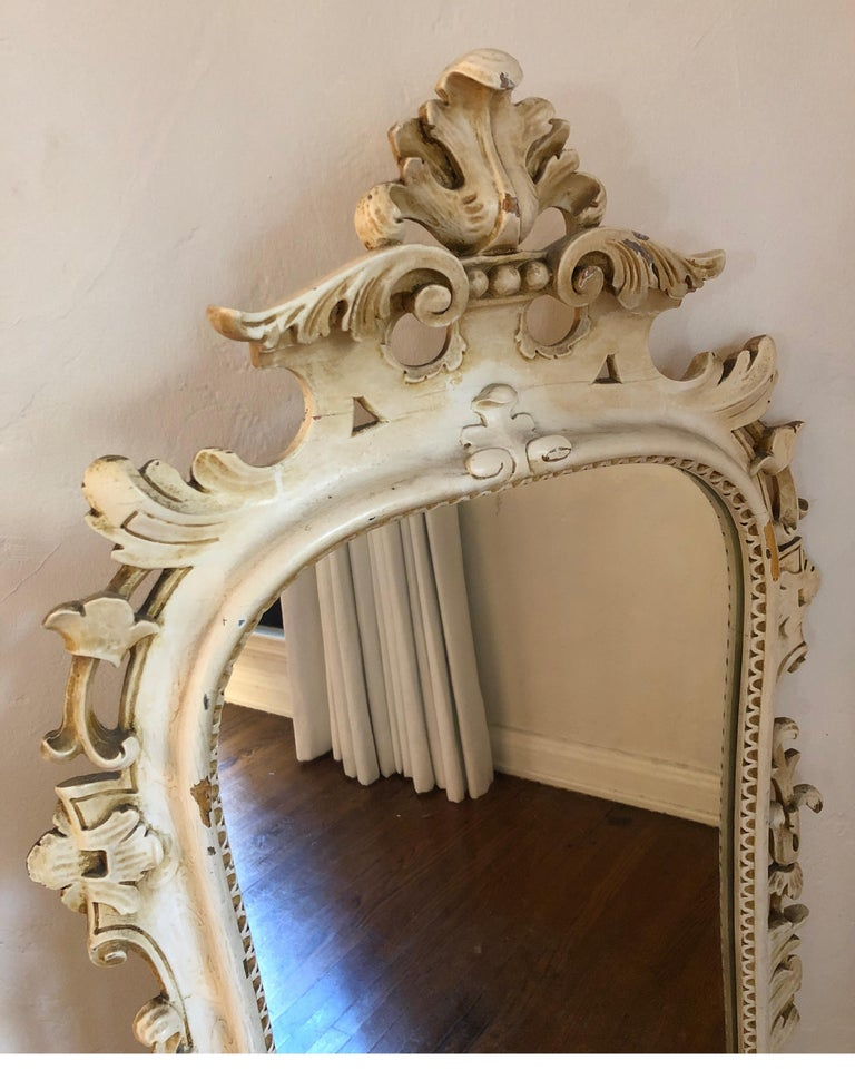Uniquely carved mirror with leaf details and interesting etching detail around wood near the glass. Also, has a raised scroll pattern detail along the frame. See pic #4. 
