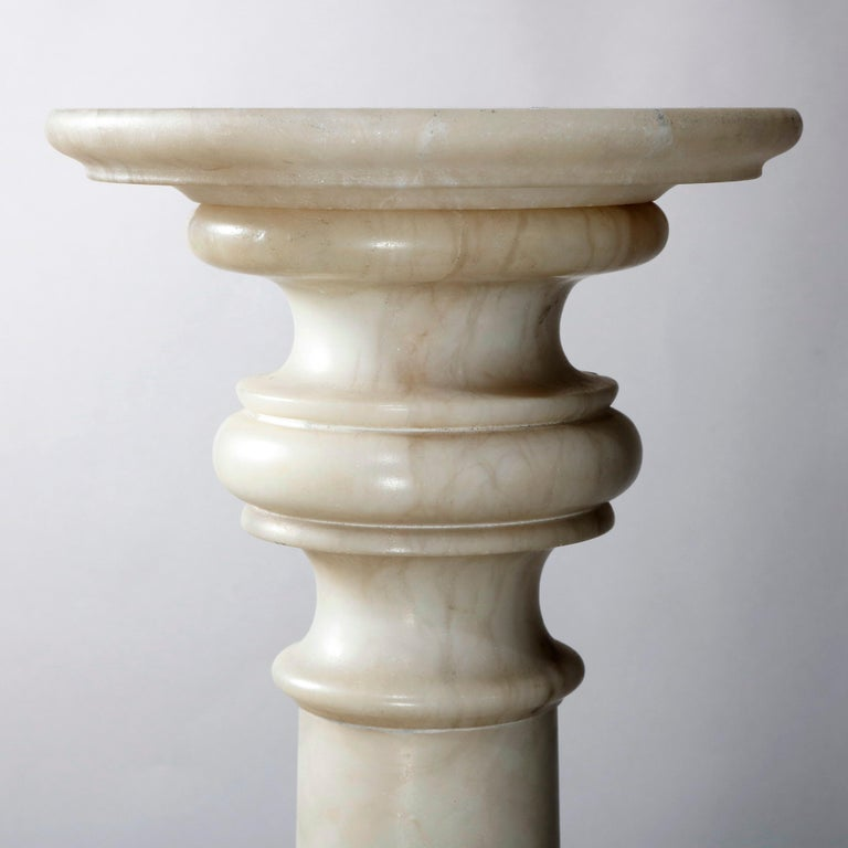Antique carved Italian sculpture display pedestal offers Classical Greek Doric column-form with central band and stepped capital and base, 20th century