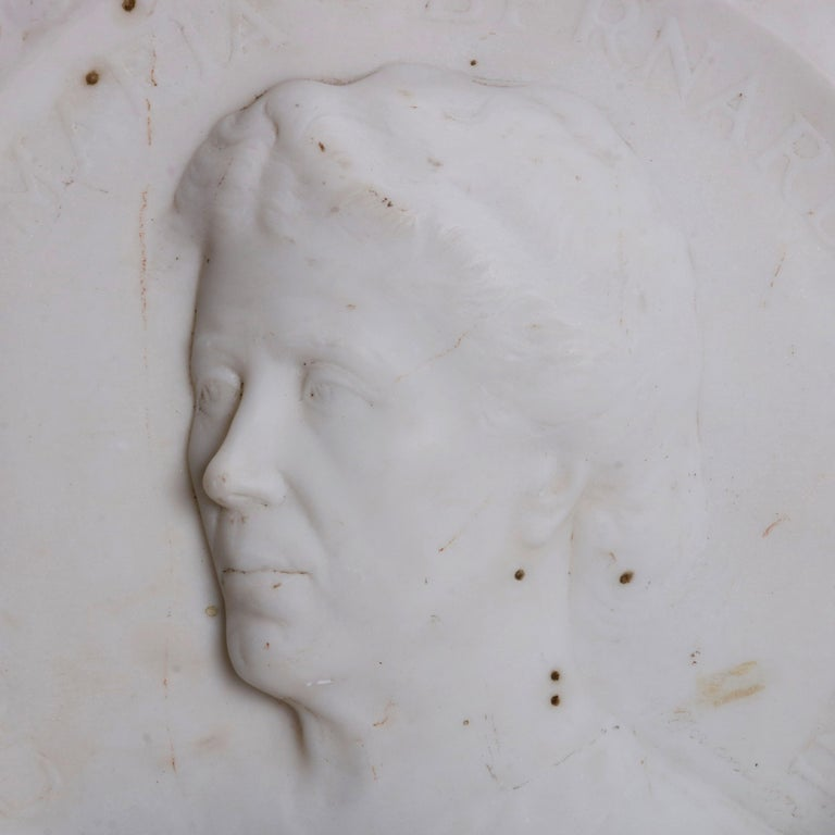 An antique Italian portrait plaque offers carved marble depiction of woman in profile and