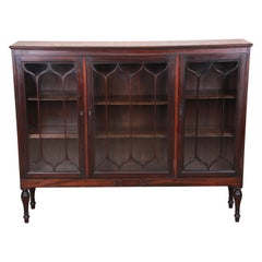 Antique Carved Mahogany Glass Front Triple Bookcase, circa 1920s
