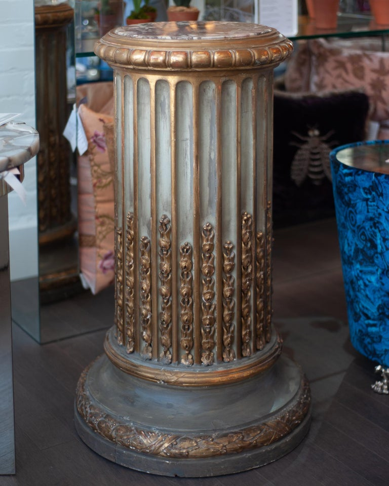 A stunning and grand antique carved Napoleon III pedestal with Breccia marble top. Ornately hand carved and gilded, this large statement piece is sure to make an impact. 12