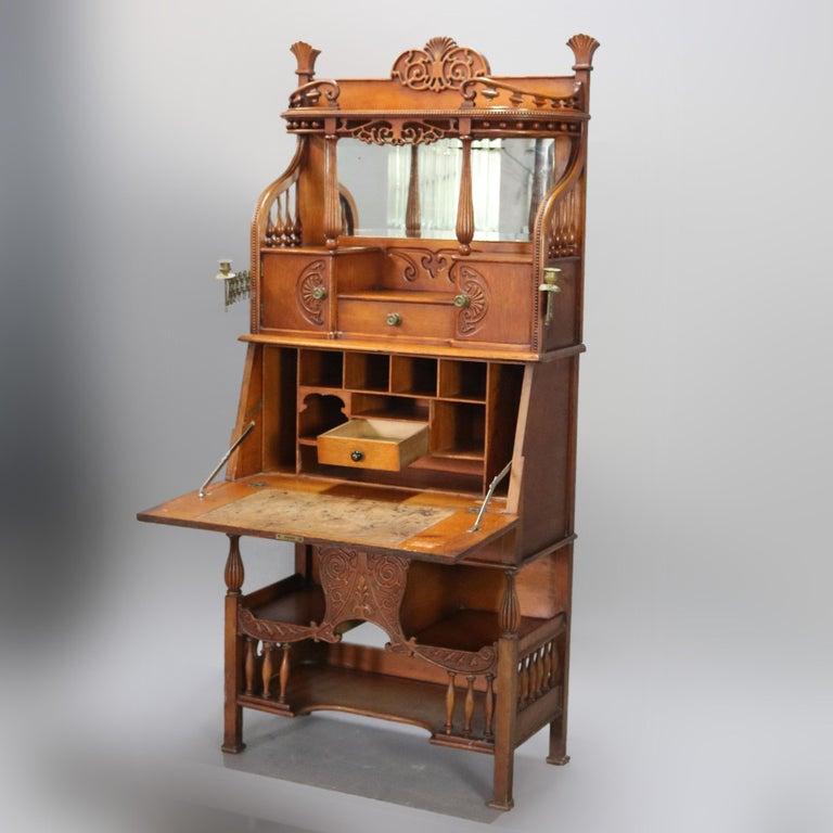 Beveled Antique Carved Oak Drop Front RJ Horner School Cowboy Desk, circa 1910 For Sale
