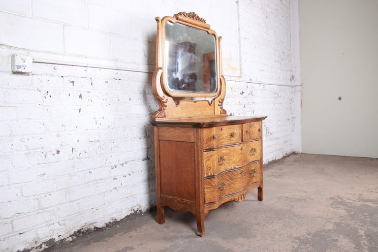 Brass Antique Carved Tiger Oak Dresser with Mirror, circa 1900 For Sale
