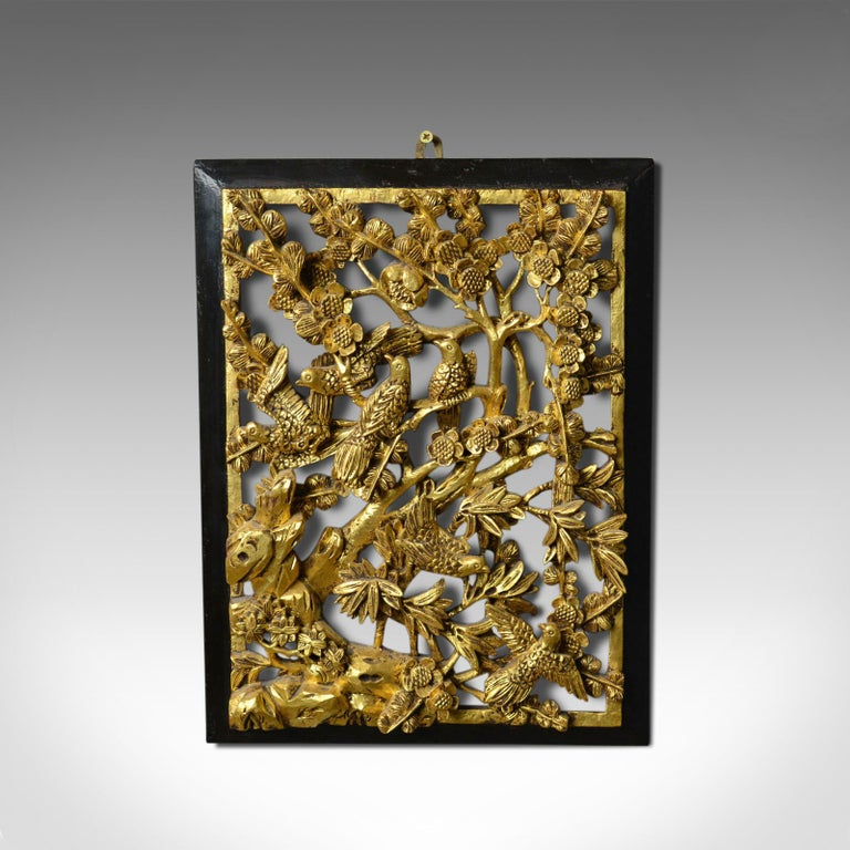 This is an antique carved wall panel. A Chinese, giltwood decorative panel dating to the turn of the 20th century, circa 1900.