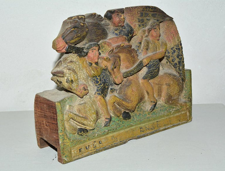 Wonderfully charming early 19th century Sicilian donkey cart fragment depicting archangels on horseback. The wood fragment is completely hand carved out of one solid piece of hardwood with hand painted features. It is painted on both sides - front