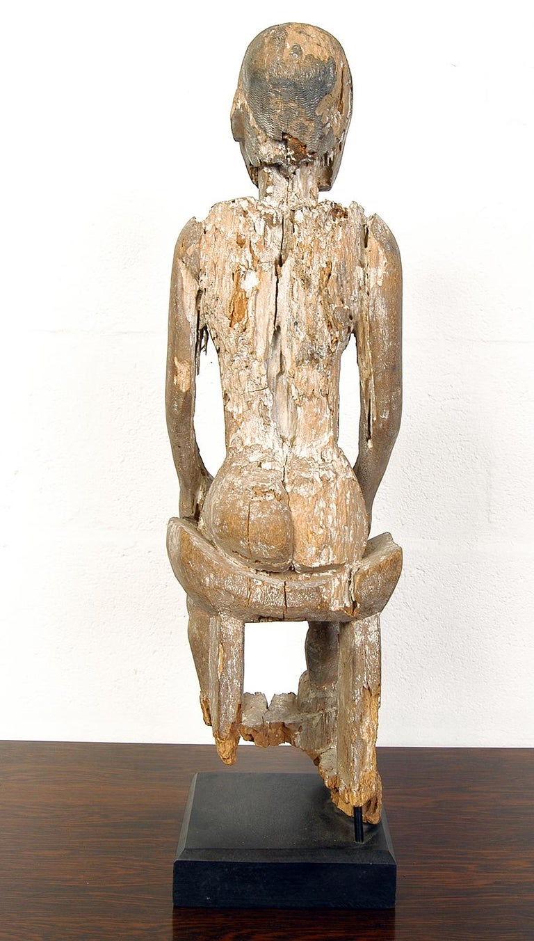 Central Asian Antique Carved Wood Folk Art Decorative Sculpture Statue Man on Ebonised Plinth For Sale