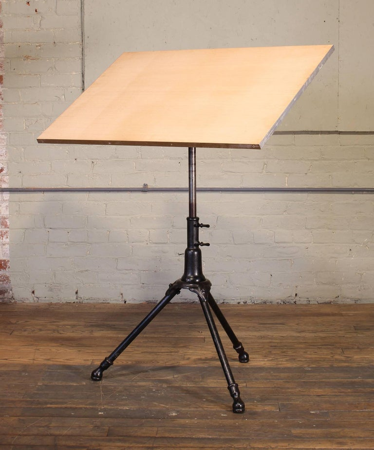 1910 drafting table by A. Hoffman Co. Blackened cast iron and steel with wood top measuring 36