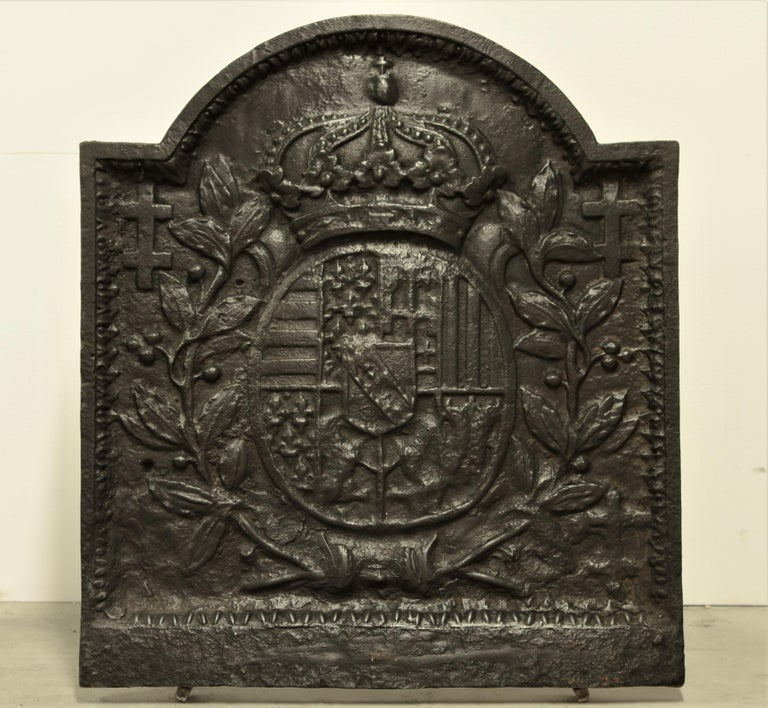 Nice French cast iron fireback showing a coat of arms.