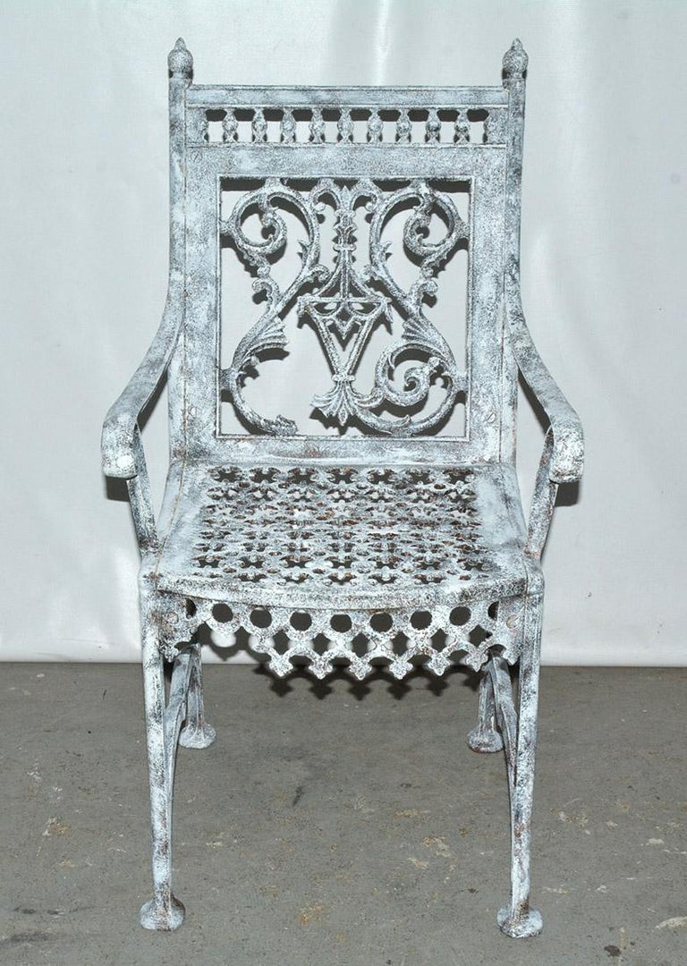 Impressive English cast iron painted garden throne chair with high back and wonderful decorative details that will add interest to any garden. Part of the decoration is missing but still holds it's charm. Please see close-up for details of missing