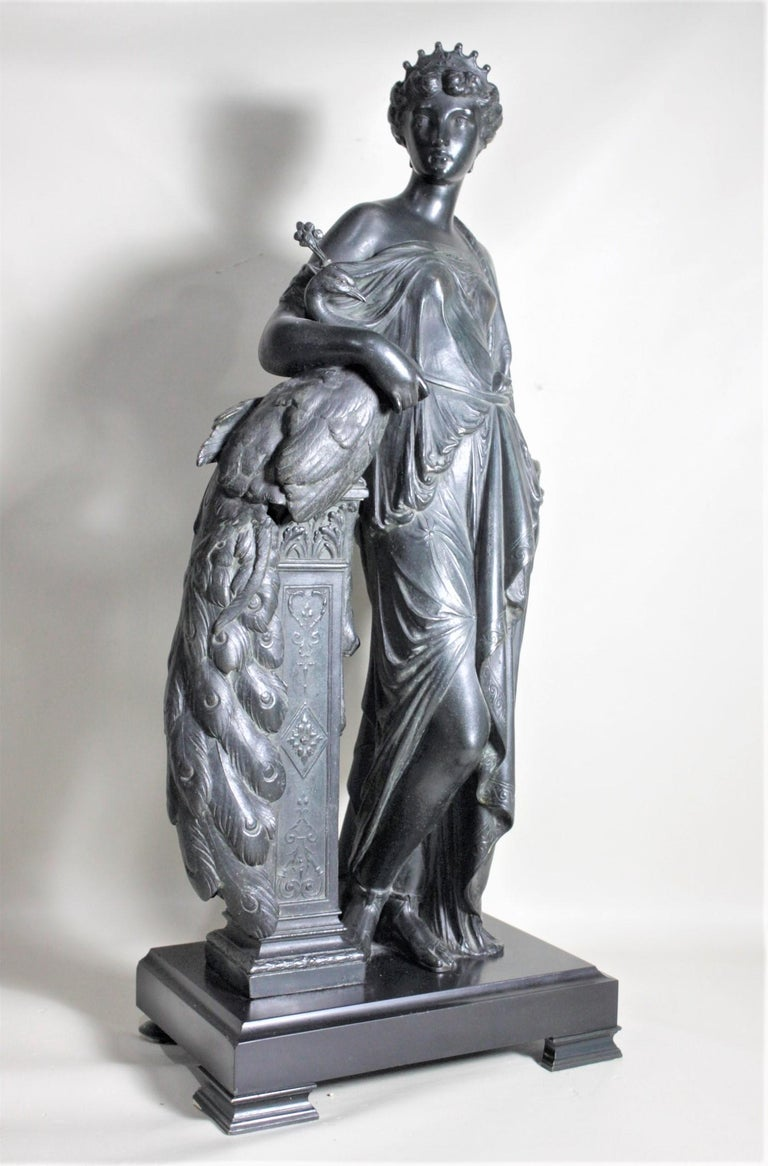 This large and substantial antique cast spelter sculpture is unsigned but presumed to have been made in France in circa 1880 in the neoclassical style. This very detailed cast sculpture depicts a robed neoclassical woman, possibly Hera the Greek