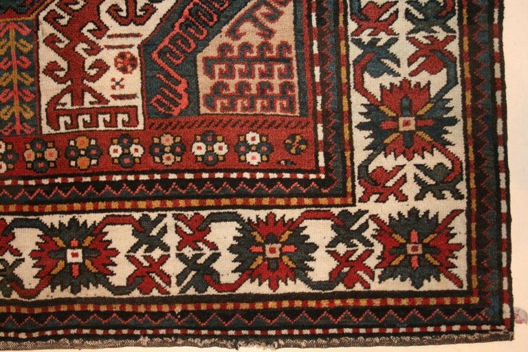 The southern Caucasian rugs of Chelaberd, Chondoresk and Kasim Ushag are all inspired by the early phase of silk Caucasian embroideries. In this finely woven, pristine example, characterized by a brilliant palette, we see a central scorpion-like
