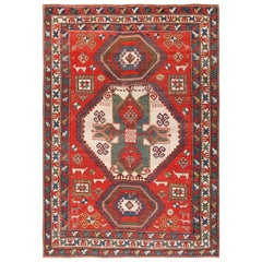 Tribal Antique Caucasian Kazak Rug. Size: 6 ft 7 in x 9 ft 2 in