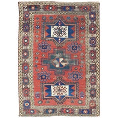 Antique Caucasian Kazak Rug with Tri-Medallion Geometric Design in Red and Blue