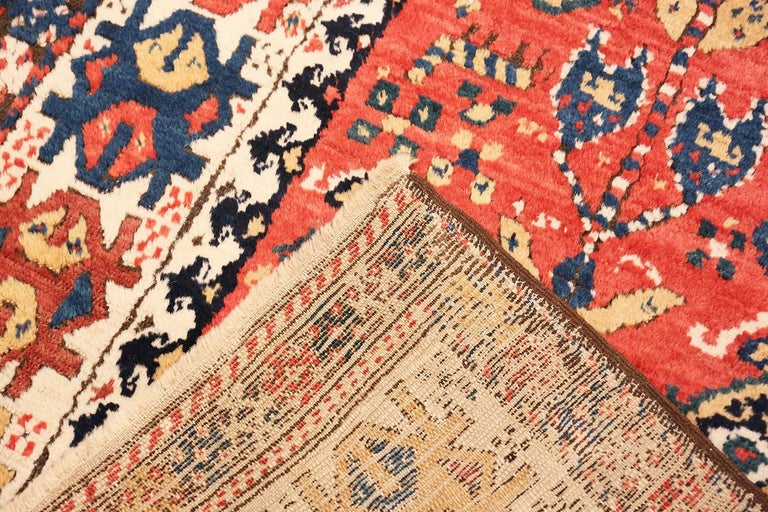 A Captivating Tribal Antique Caucasian Kazak Runner Rug, Country of Origin: Caucasus, Circa Date: 1890. Size: 4 ft 1 in x 10 ft (1.24 m x 3.05 m)  The antique Caucasian Kazak rugs have a tribal quality that is mysterious and ancient. The symbols