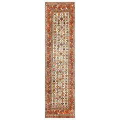 Antique Caucasian Kazak Runner. Size: 3 ft 5 in x 12 ft 3 in (1.04 m x 3.73 m)