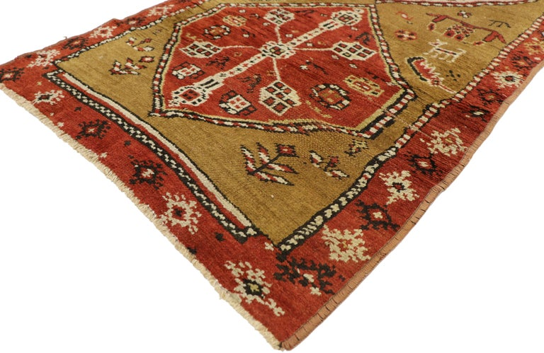 72223, antique Caucasian Tribal runner, hallway runner. This beautiful antique Caucasian hallway runner features hexagonal medallions surrounded by ancient symbolic motifs and animal figures on an abrashed camel-colored field. It is framed by a thin