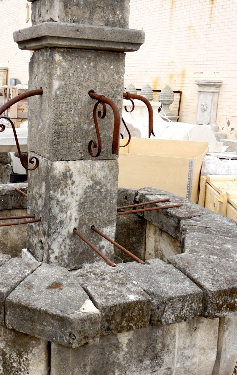 Here we offer an octagonal central fountain hand carved from limestone with four iron spouts. This fountain is very clean and straight in it's appointments and basin wall. This fountain will go nicely with any decorative style as it's age will lean