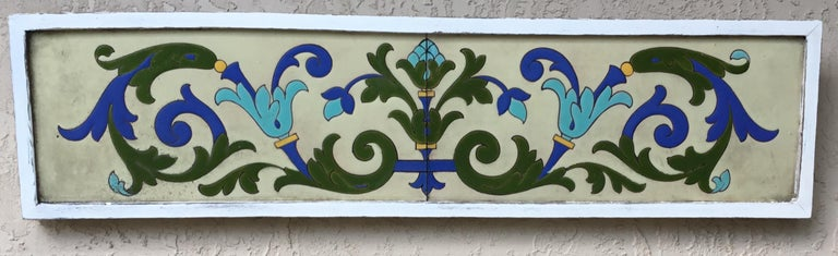 Exceptional ceramic wall hanging made of two tiles, handmade painted and glaze, beautiful motifs of flowers and scrolling vines, with vibrant colors of turquoise ,green and cobalt blue on a cream color background. The wall hanging is professionally
