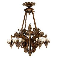 Antique Chandelier. Wood and bronze chandelier with cherubs
