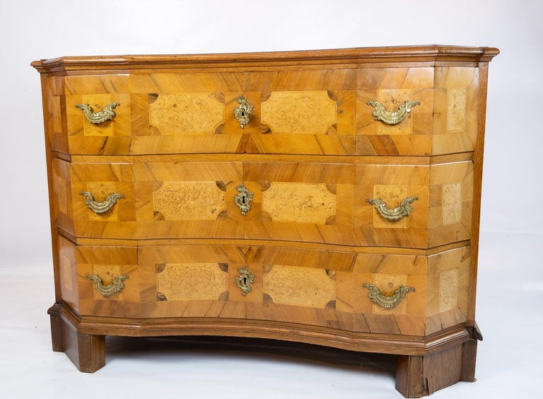 Antique chest of drawers in walnut and fruit wood decorated with brass handles from South Germany, circa 1780s. The chest is in great antique condition.