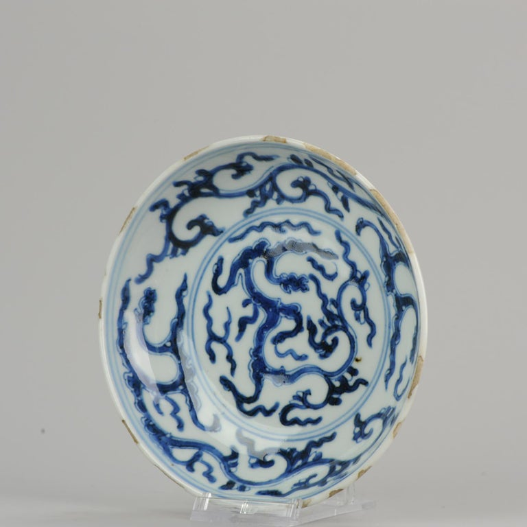 Rare and nicely decorated dish, 17th century piece. Truly nice cobalt blue color rare scene several dragons, in the central plate and also in the border. 9-8-19-1-11 Condition: Overall condition a very good. Rimfritting and 1 firing flaw in