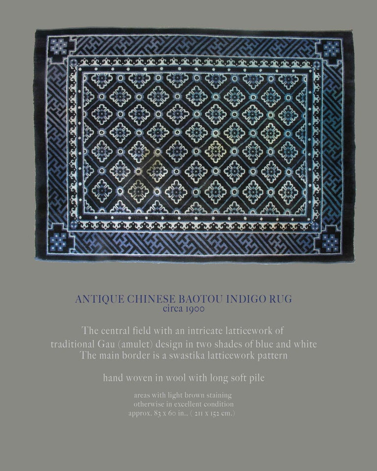 Antique Chinese Baotou indigo rug, circa 1900. The central field with an intricate lattice work of Traditional Gau (Amulet) design in two shades of blue and white. The main border is a swastika lattice work pattern, handwoven in wool with long soft
