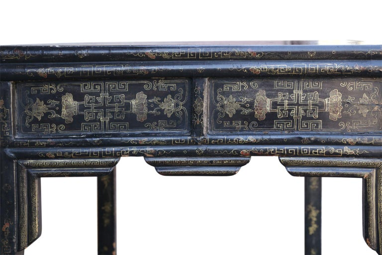Antique Chinese black lacquer table (circa 1880-1920) constructed using mortise and Tenon joints as well as nails. Signs of vintage restoration under top. Designed to emulate the form of a bamboo table. Adorned with gilt and painted decoration (see
