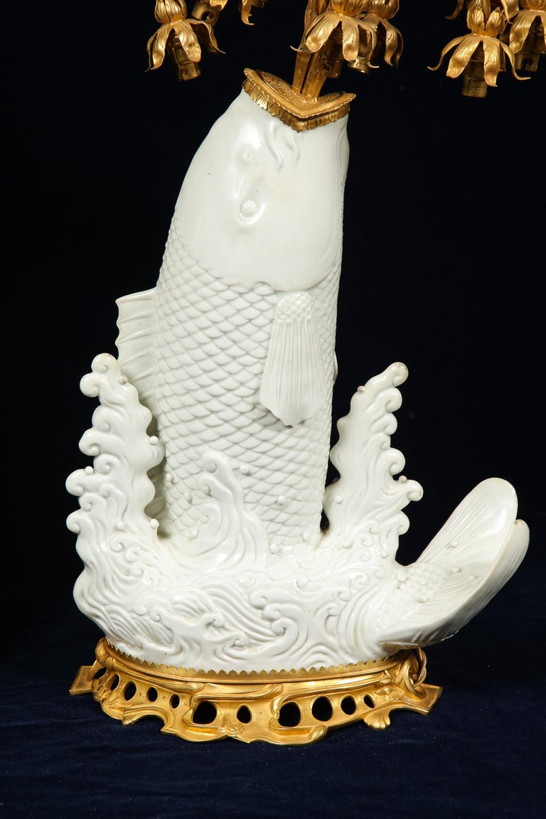French Antique Chinese Blanc de Chine Porcelain and Doré Bronze Mounted Fish Form Lamps For Sale