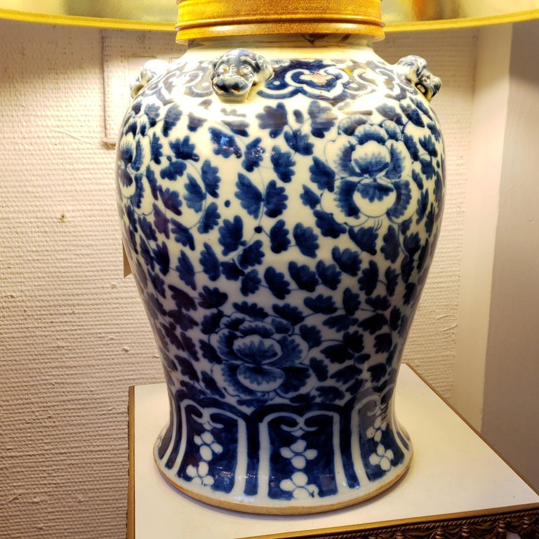 Stunning blue and white Chinese porcelain lamp. No markings on the underside. The jar was not drilled rather the wooden top was for wiring purposes. The color is deep and beautiful. The upper sections surrounded by 4 food dogs. The cap for the turn