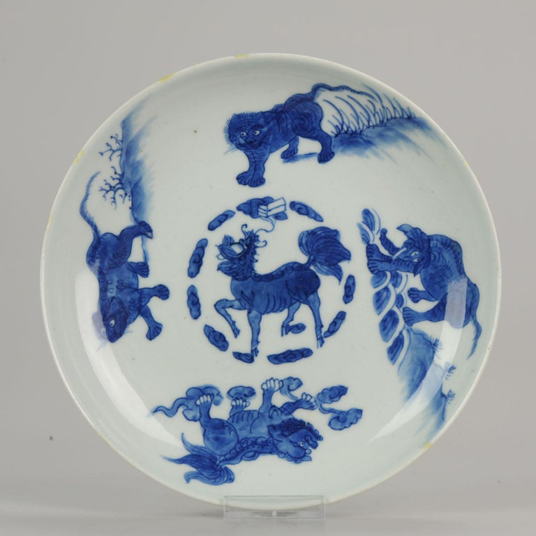 A very nice plate with animals, early 17th century. Rare plate!  22-10-19-1-2  Symbolism:  Tiger: King of the wild animals, the tiger is a symbol of courage and bravery and it can drive off demons.  Leopard - one of the four Animals of Power