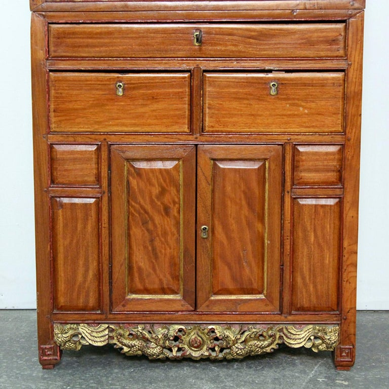 Antique Chinese cabinet with gilt decoration, hand carved.