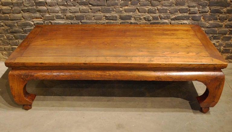 A Chinese Kang bed that was completely made in Ju Mu or elmwood. The wood shows a beautiful dark grain and it has a rich and warm honey color with great patina and gloss. A Kang bed is primarily served as a bed placed in the living quarters were