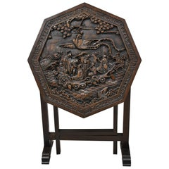 Antique Chinese Carved Hardwood Folding Gate Leg Table with Figural Carvings